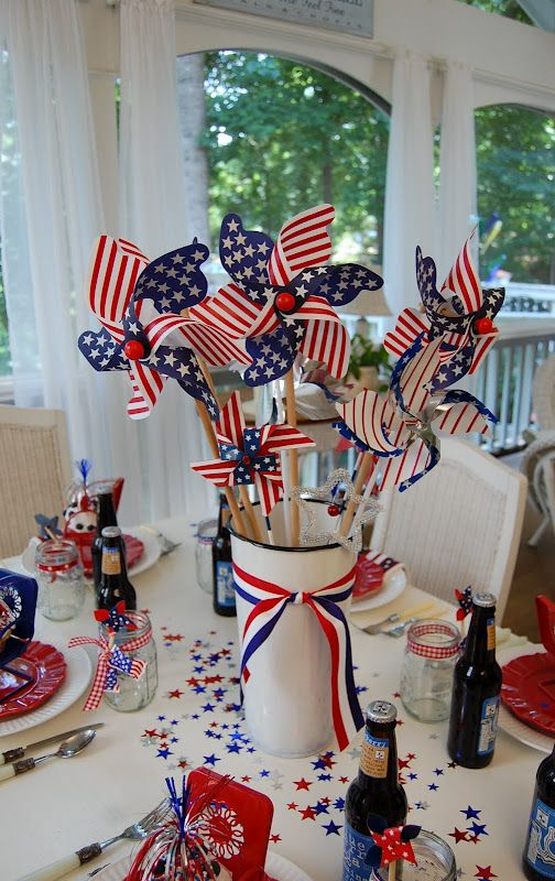 4th of July Table Centerpiece. White metal container filled with red,white and blue pinwheels and finished off with ribbon. So easy!