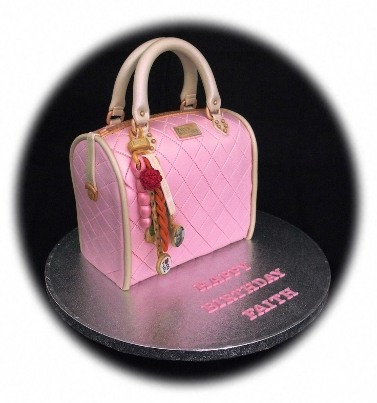 - 4 layers of Chocolate Madeira filled with chocolate buttercream and covered in pink sugarpaste. Modelling paste handles and charms and the handbag is sprayed with Dr. Oetker silver shimmer spray for a pearlised effect.