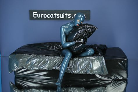 latex bedding - black / metallic pewter , with metallic-peacock latex catsuit