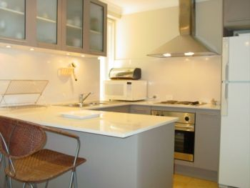 Facing Bondi Beach, this apartment has a very attractive wrap around kitchen.