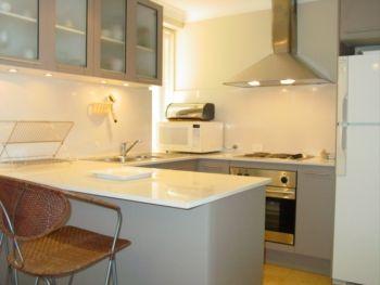Facing Bondi Beach, this apartment has a very attractive wrap around kitchen.