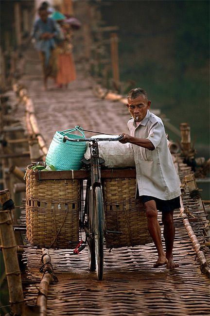 This Bamboo brigde is about 150 meters, located at Pundong vilage, southern Yogyakarta (Central Java). Every morning, hundred peoples using this slippery bamboo bridge to cross the river, going to the market or school.