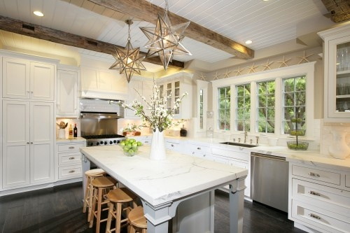 reclaimed wood beams, and white cabinetry with star pendants lights.