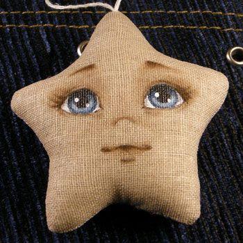 colgante  de tela en forma de estrella http://cestosycestas2.blogspot.com.es/