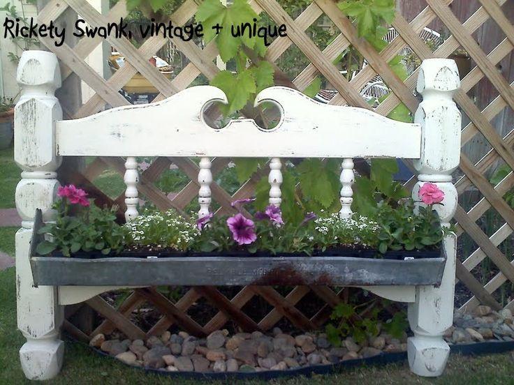 Bed post with chicken feeder flower box!    http://www.facebook.com/ricketyswank