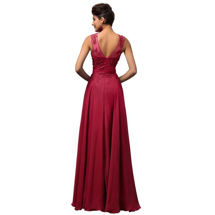 Prachtige rode lange jurk met rok van organza en top bewerkt met kant en kralen. Achterzijde.