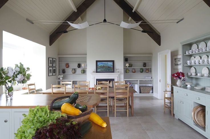 Kitchen | Architect Richard Falconer designed this wonderful room. Contemporary 'sail' lights hang between the side walls. I think it is a perfect living area for family holidays.