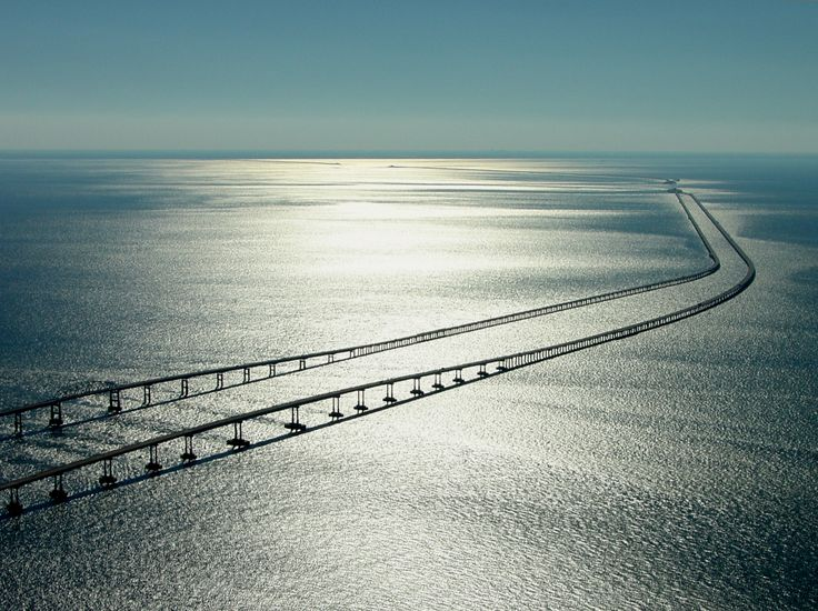 Chesapeake Bay Bridge Tunnel - It is 17.6 miles long from shore to shore. It has two one-mile long tunnels for ship crossings. It is intended to save miles and time for the traveler.