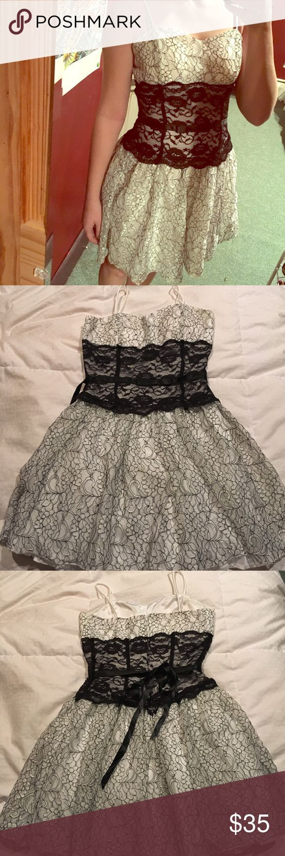 Black and White Lace Party Dress Black and white lace dress. Has padding in the bust, very structured, has netting to make the skirt have volume. Only been worn once! In perfect condition. Taboo Dresses Prom