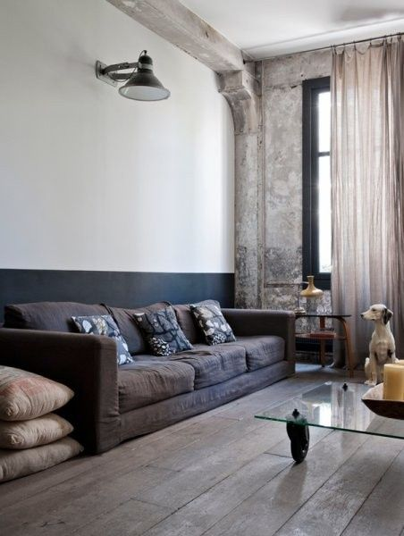Masculine interior Grey. Wondering what the did on the window wall. Looks like stained concrete.