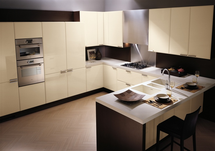 Glam by #Scavolini. The peninsula is perfect both as a work-top  and as a table for informal get-togethers. #kitchen