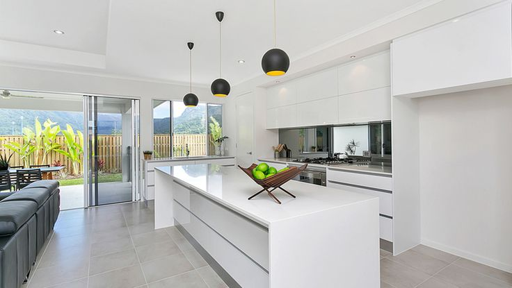 Entrant - Pacific Kitchens. Month - August. Products used - the doors, fronts and panels are all Laminex CrystalGloss Polar White and the benchtops are essastone dusk.