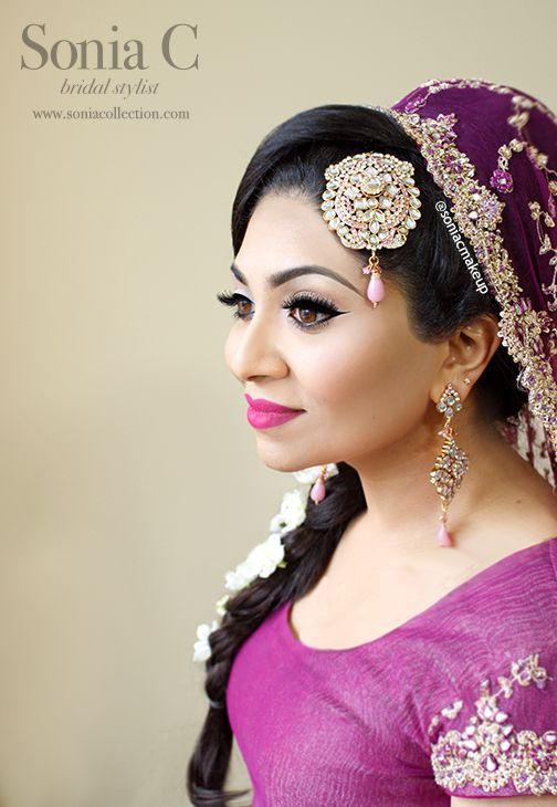 pink bridal makeup look, bold lips and black liner. pakistani bride, desi bride, south asian bride, indian bride, bengali bride. perfect for a grab, sang or mehndi event. bridal makeup and hair, tikka, pasa, jhoomar, kundan
