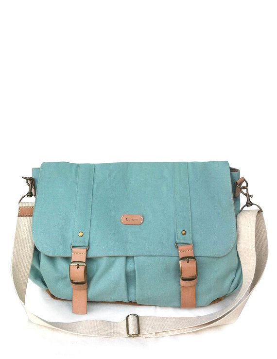This turquoise messenger bag is made with  100% COTTON canvas Its quite a large bag created for your everyday use.. All of the large pockets in front are covered. The interior is very roomy with many pockets. Zipper would just close it neatly, tidy and safely.