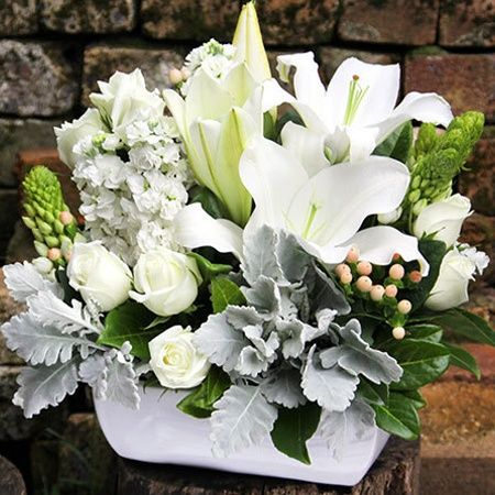 """Buy """"A Garden Of Memories"""" for $132.95. Aclassic Flower Arrangement Of Scented Blooms In Fresh White, Green And Silver. Conveniently Arranged By Our Florists In A White Ceramic Pot, Itfeatures A Floral Garden Ofperfumed Oriental Lilies, Pure White Roses, Silvery Dusty Miller Leaves, And Fluffy White Stems Of Stock (or Similar), Alongside Seasonal Blooms And Berries. This Flower Arrangement`s Heady Scent Is Sure To Invoke Memories Shared With Loved Ones. Organise A Flower Delivery Via Our…"""