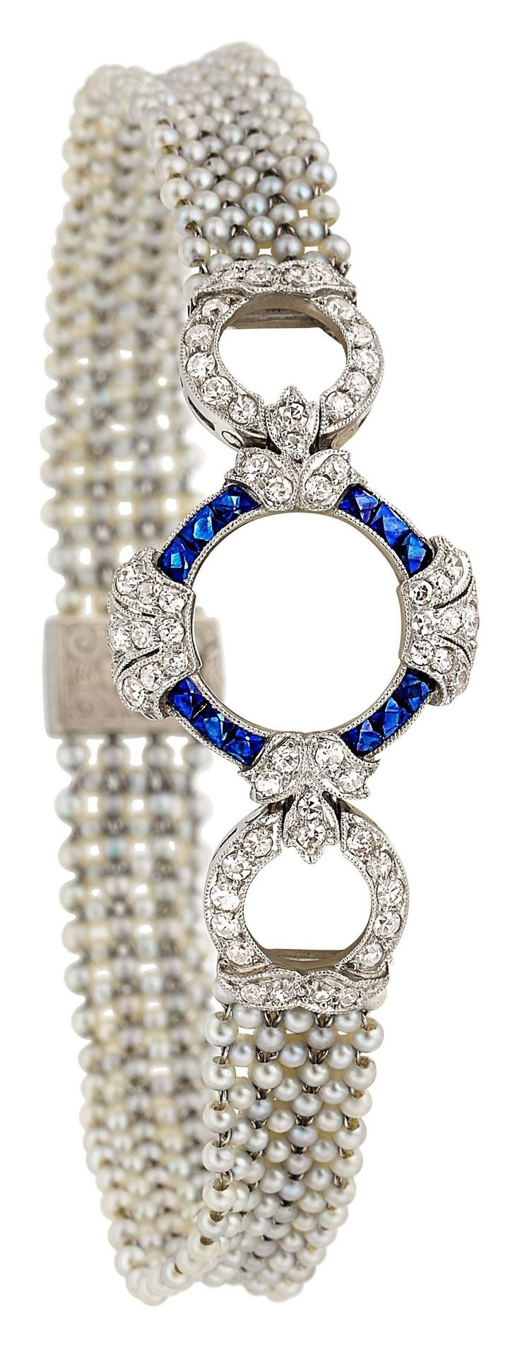 An Art Deco Diamond, Sapphire, Seed Pearl, Platinum Bracelet. Composed of seed pearls, forming seven strands strung along platinum wire, enhanced by full and single-cut diamonds, accented by French-cut sapphires, completed by a platinum clasp featuring full-cut diamonds. #ArtDeco #bracelet
