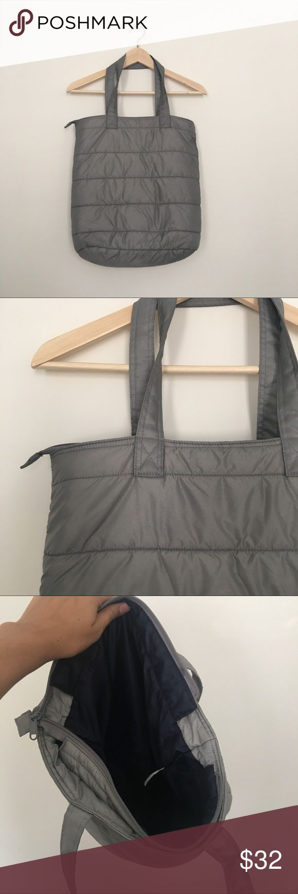 Uniqlo NWOT grey down insulated tote bag Wear your comfy down as a bag in the summer and have an instant pillow wherever you choose to lounge 👍 Uniqlo Bags Totes