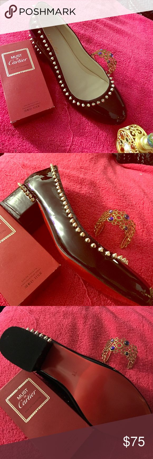 Black shoes with spikes and red soles Black shoes with spikes and red sole. This shoes were made for me but when I received them I realized the front was too short for me. I don't like to wear shoes that let my toes out. They are made with good leather. Shoes Flats & Loafers