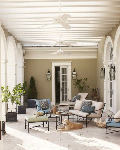 Architectural detailing in this outdoor living is stunning. White, soft neutrals, blues and greens. Airy and inviting.