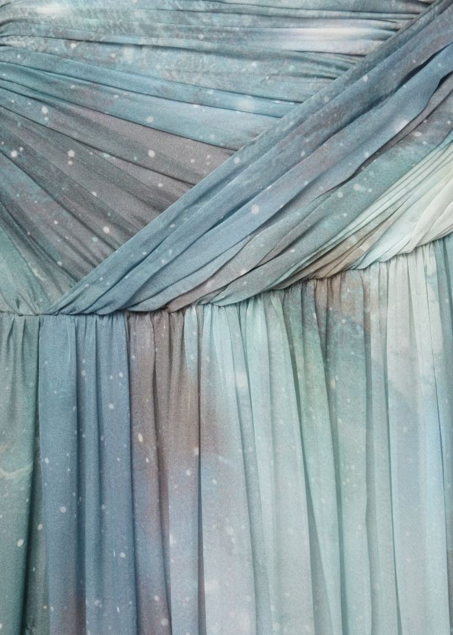 Stars glitter in the darker skies as galaxies swirl far away - details of the the Matthew Williamson AW15 aquamarine patina galaxy maxi skirt. Click to see it up close.