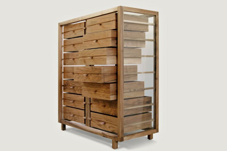 Chest of drawers in solid walnut with 8 or 14 drawers in two columns. The handles are leather, sides and back are glass and the top is glass or leather.