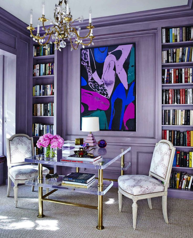 "The library is what Nathan calls ""French Lavender"" and features a show-stopping, vintage brass and Lucite desk from the 1960s."