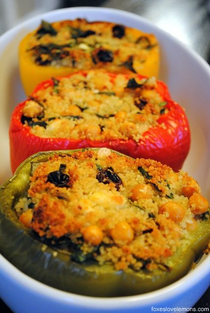 Couscous-Stuffed Peppers with Basil Sauce - a filling meatless meal that will even satisfy meat-eaters! From Giada De Laurentiis. | foxeslovelemons.com
