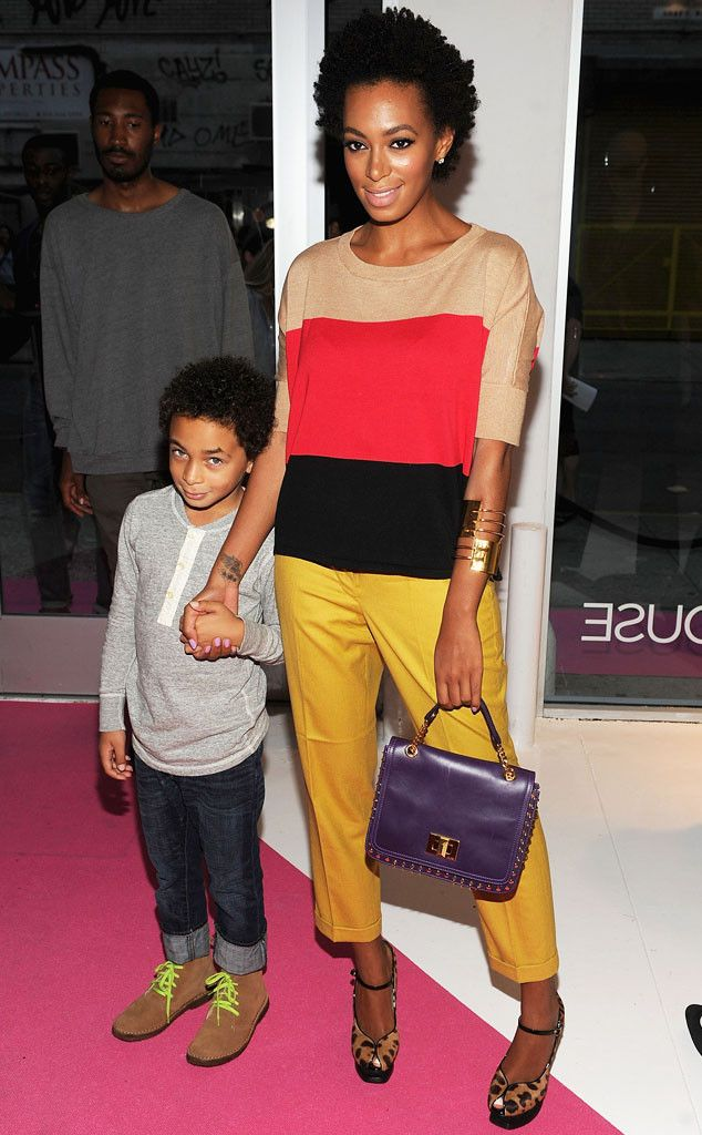 Color Blockin' from Solange Knowles' Best Looks In a color-blocked sweater, marigold pants and leopard print platforms with an Emilio Pucci bag.