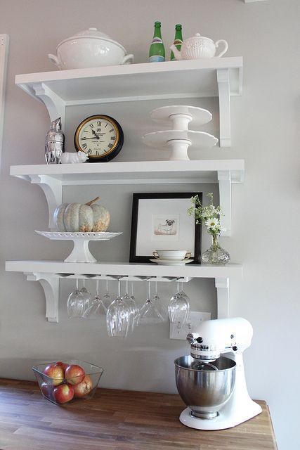 Love the idea of wine glass shelves over a buffet table in the kitchen.  It would make a great bar area!  I would add a wine rack.