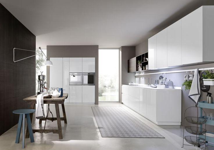 Concrete floor - darker stone look walls & white units. Pedini London, Vintage Kitchen, Showroom, Designer Kicthens