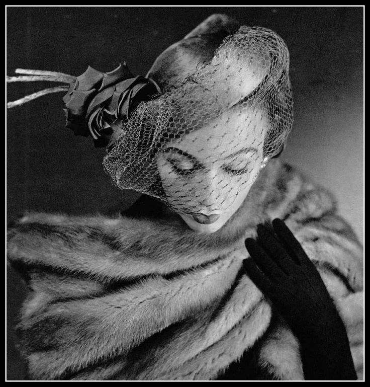 Sophie Malgat in tricorne hat of green baize rolled on its side adorned with green rose and sheet voilette by Albouy, photo by Pottier, 1950