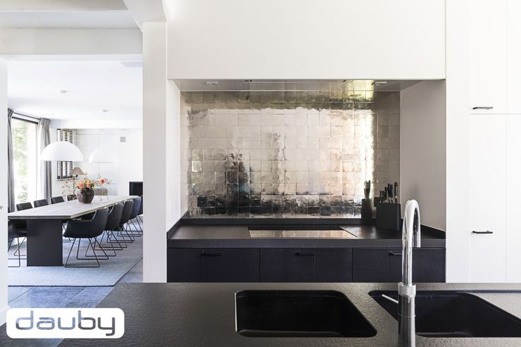 Beautiful tiles in white bronze. Perfect combination with the black cupboards.   Interior by Architect Paul Rijs  More inspiration on www.dauby.com