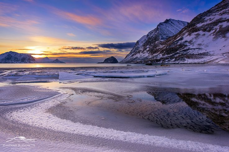 Haukland Sunset - Haukland Beach is located on the island of Vestvagoy in the Lofoten Islands of Norway. This is one of the most popular beaches in the islands, with its white sand and crystal blue waters. This photo was takken in February at sunset. A tidal pool framed by ice lies in the foreground, with the mountains in the background.