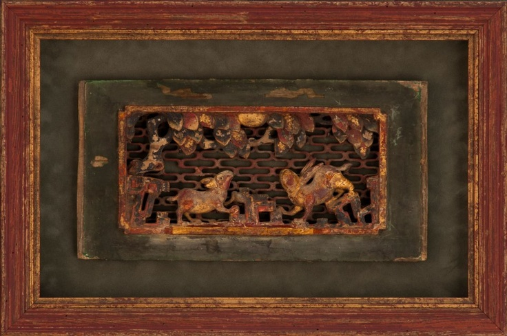 This is an antique Asian wood carving. Rather than framing it in the typical American idea of an Asian frame, meaning bamboo or lacquer, this is framed in a distressed painted wood to mimic the chipped paint finish of the carving. The gold fillet adds a touch of elegance, while maintaining the aged look.