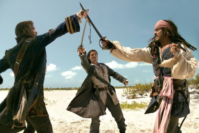 Still of Johnny Depp, Orlando Bloom and Jack Davenport in Pirates of the Caribbean: Dead Man's Chest
