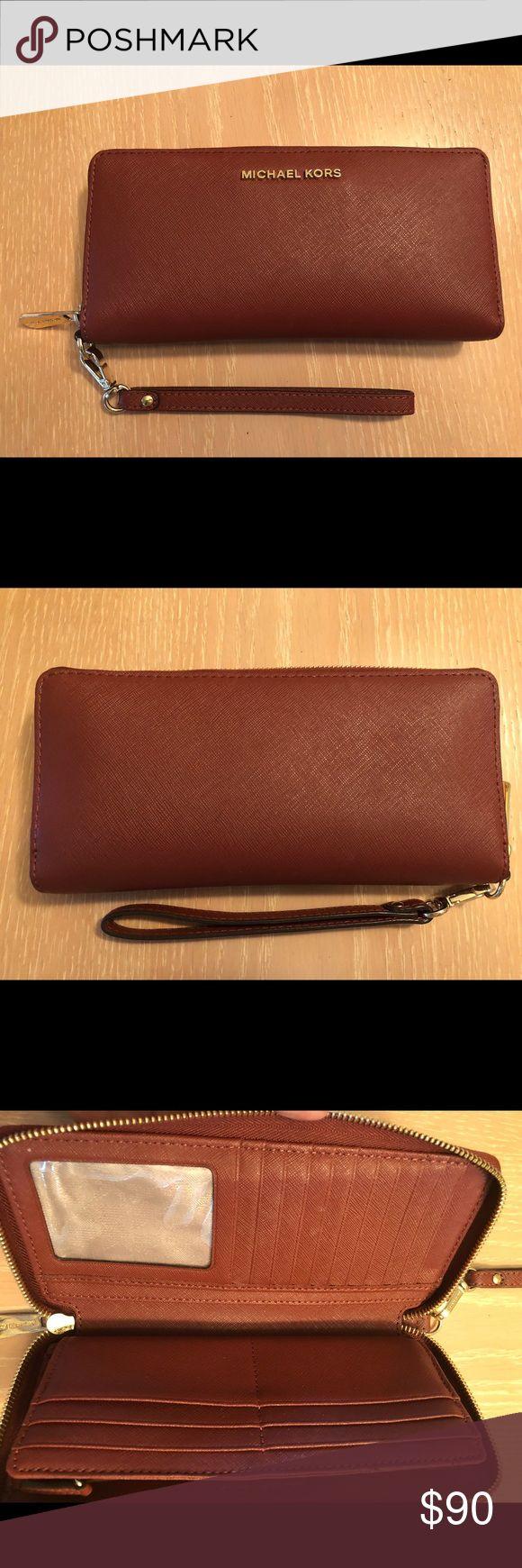 Michael Kors Jet Set Travel Continental wallet MK jet set travel continental wallet.  Color- Brick Size- 8.5x4.5 in Michael Kors Bags Wallets