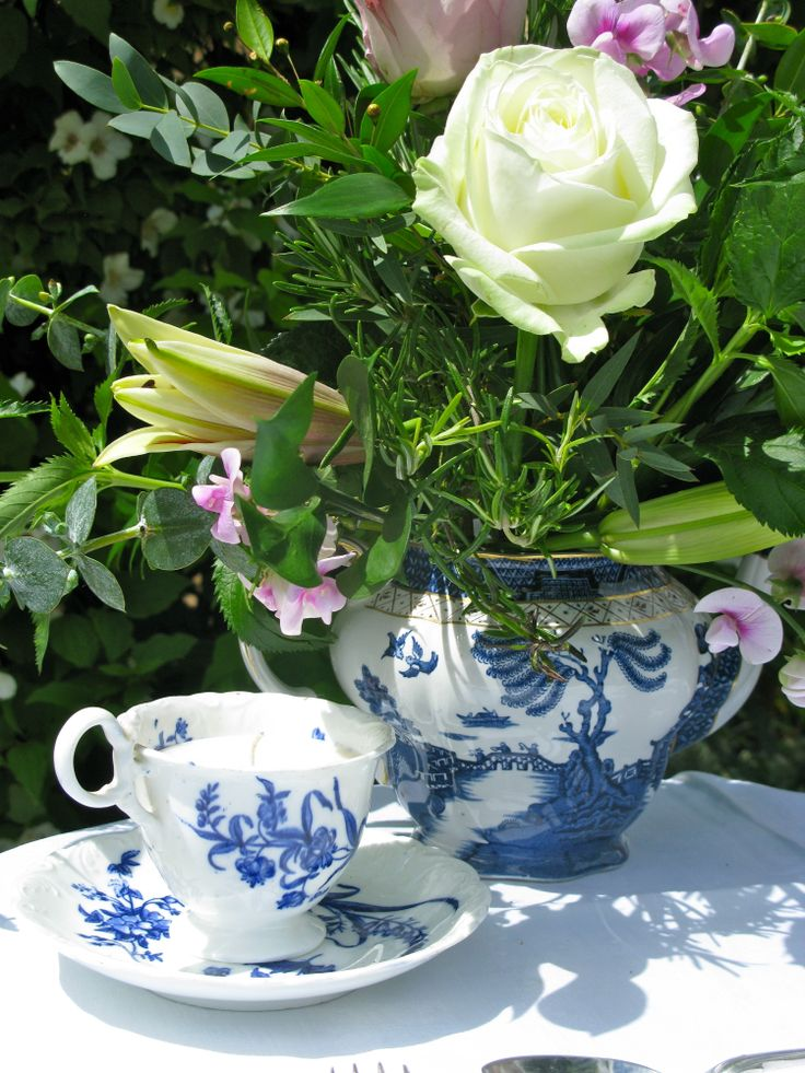 Blue and white is always classic and suitable for every occasion and every interior.  Here an early Victorian footed teacup and saucer from the 1840's with a late Victorian Willow Pattern teapot c 1900
