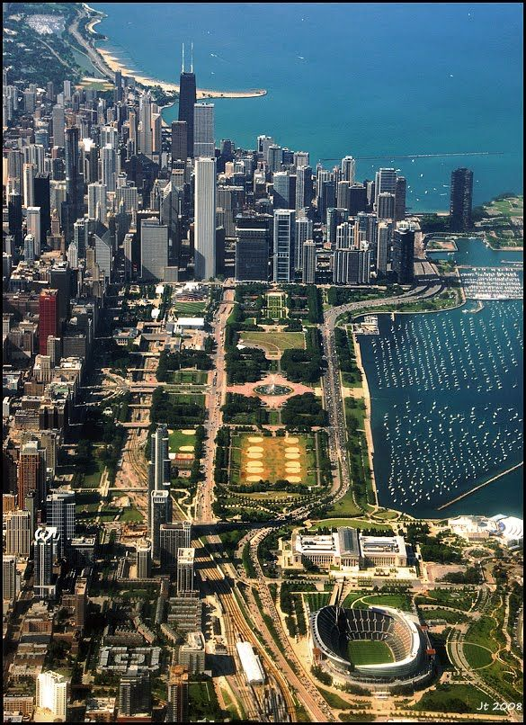 This is a great view of Chicago-Soldier Field in the bottom right. Just above it in white, the Field Museum and to the right of that the Shedd Aquarium.  North through Millenium Park, then the Streeterville buildings where I used to live.  The sand bar jutting out in the north of the Hancock Building is Oak Street Beach