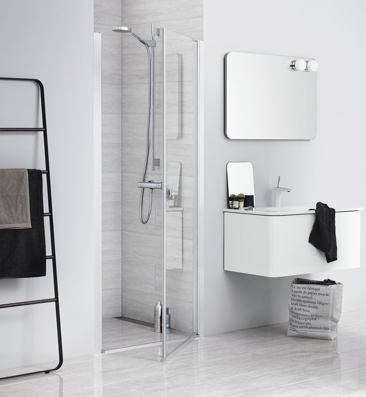 Attractive UNIQUE door showering solution for cubicles of different widths. Ultra minimalistic Dansani Curvo bathroom furniture with round corners.