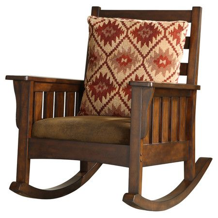 Add a lovely touch to your den or home library with this handsome rocking chair, showcasing a solid wood frame and dark oak finish.