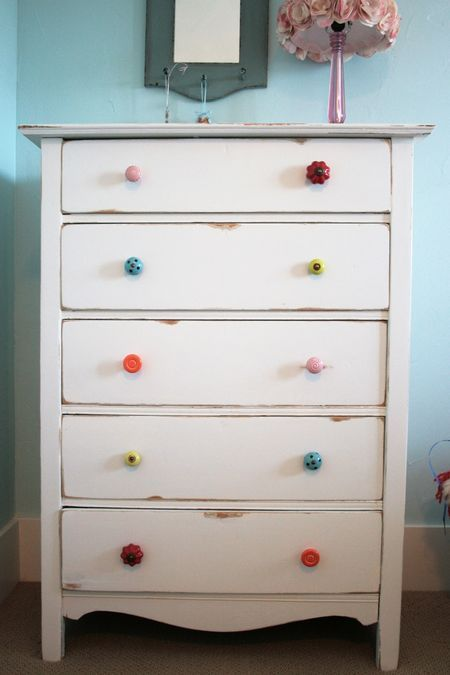 Different Colored Drawer Knobs on White Dresser