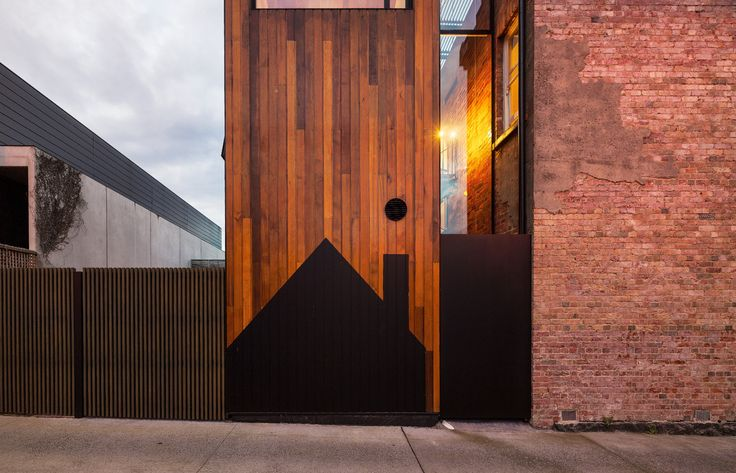 This timber and brick combination is continued throughout the house. - House House