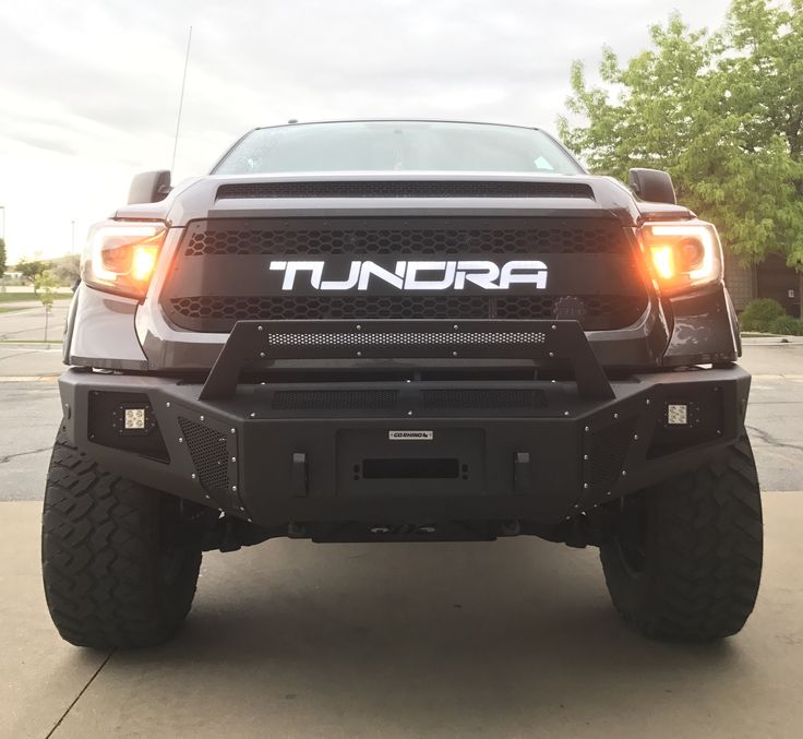 2014 Toyota Tundra supercharged with go rhino front and rear bumpers.....