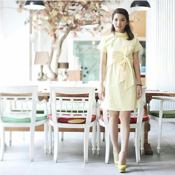 Perfection wraps up in Joanna Dress!  _  Leading fashion influencer and style stealer, Ms @anazsiantar shows her vibrant personality in this stunning high neck pastel yellow dress.
