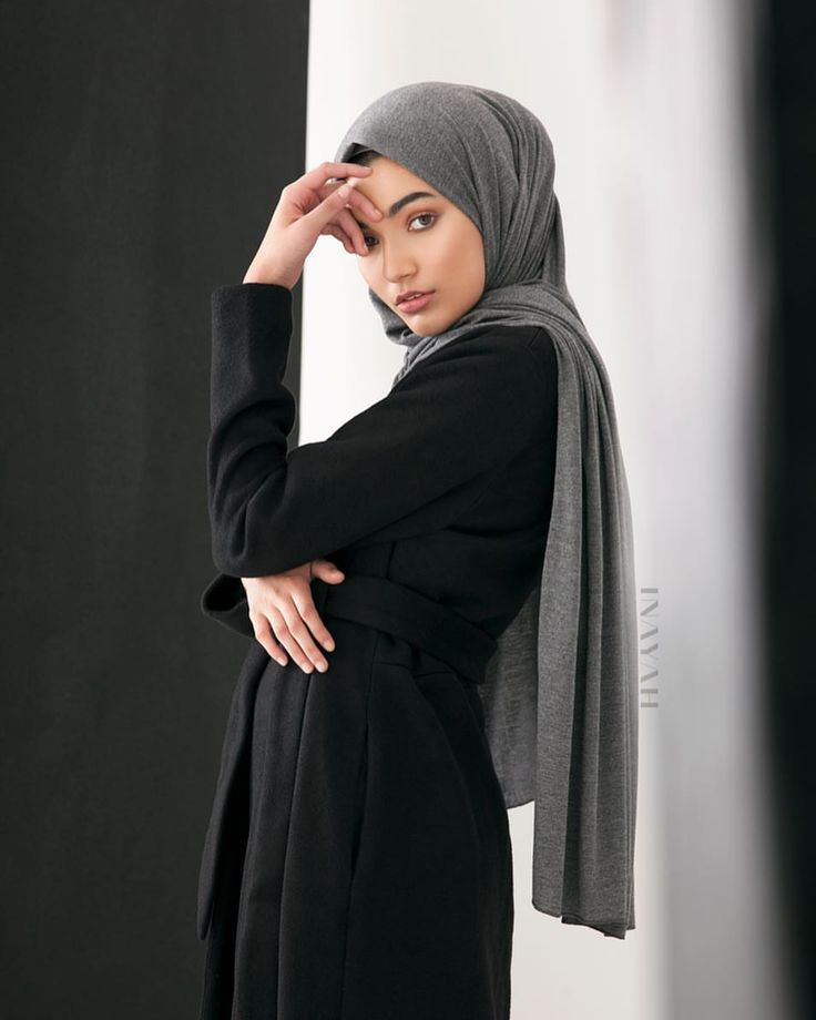 INAYAH | Stay warm and stylish with our contemporary woollen maxi coats; we used structured wool to create the ideal modest maxi coat. Black Classic Wool Belted Maxi Coat + Dark Grey Rayon Blend Jersey - www.inayah.co