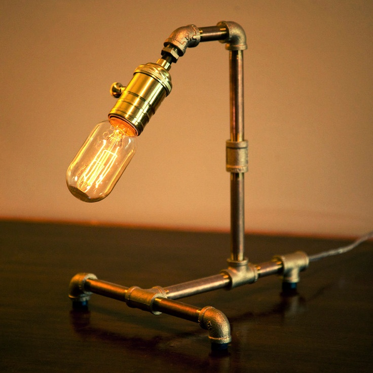 Nice dramatic touch for a bedroom nightstand.  Medium Red Brass Pipe Steampunk Desk Lamp. $120.00, via Etsy.