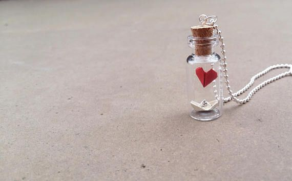 This beautiful glass bottle pendant has a mini paper heart and a boat inside. Bottle Size: about mm x mm. This would make such a lovely gift for someone who really appreciate the small, beautiful things in life. All the products are shipped well packaged, in a custom packet with a