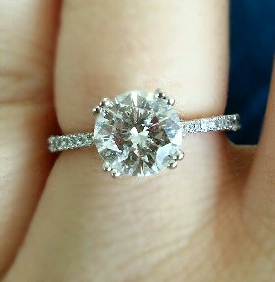 Round center stone with thin diamond band engagement ring The Big Day