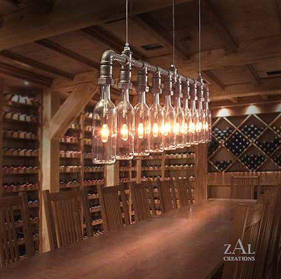 lámpara techo en línea, hecha con trozos de tubería (lineal, forma de T, codos, tuercas para golletes botellas) bombillas y colgantes botellas de vino ---industrial vintage lighting - Hanging Wine Bottles in Celler.