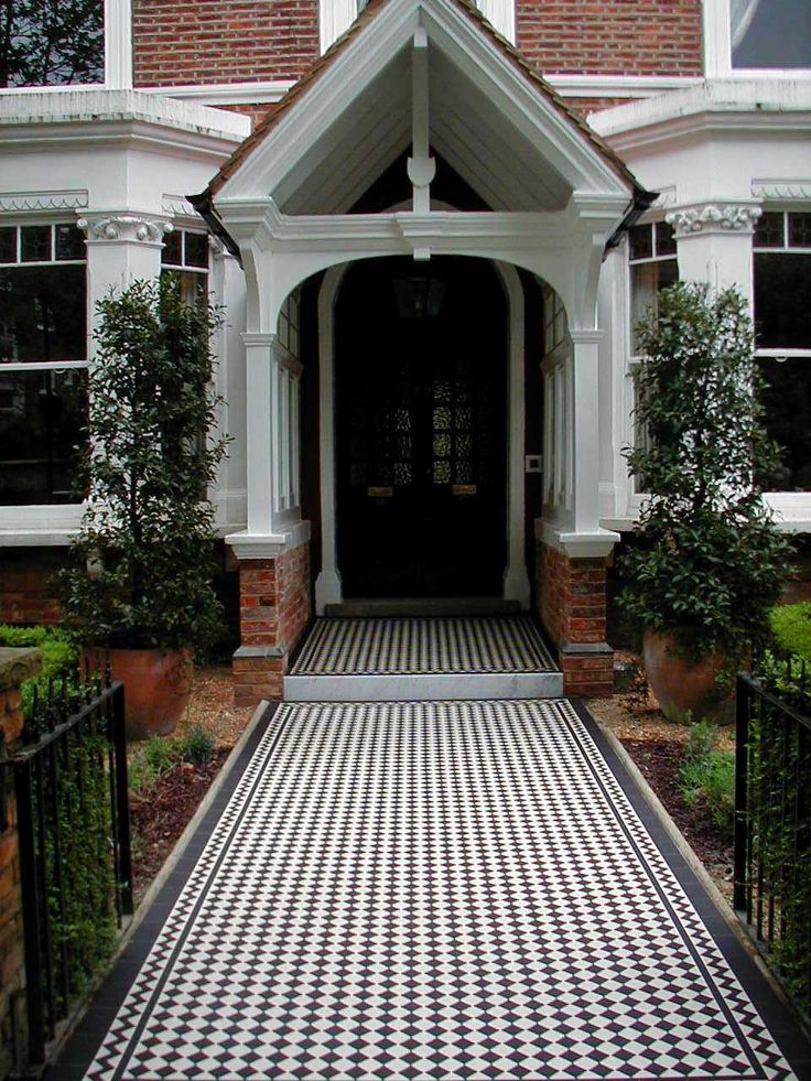 What a grand entrance! Black and white Ennerdale tiles with a Classic border create a gorgeous runway to your front door. Find yours here: http://originalfeatures.co.uk/olde-english-tiles/olde-english-tiles-range.html